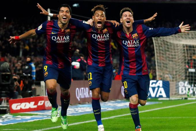 Barcelona's Suarez, Neymar and Messi celebrate a goal against Atletico Madrid during their Spanish First Division soccer match in Barcelona