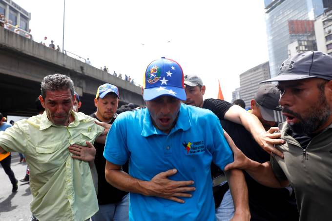 Opposition leader Henrique Capriles is overcome by tear gas during an opposition rally in Caracas