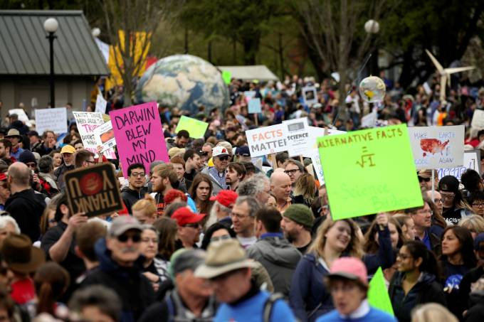 Protestors hold signs during the March For Science in Seattle, Washington
