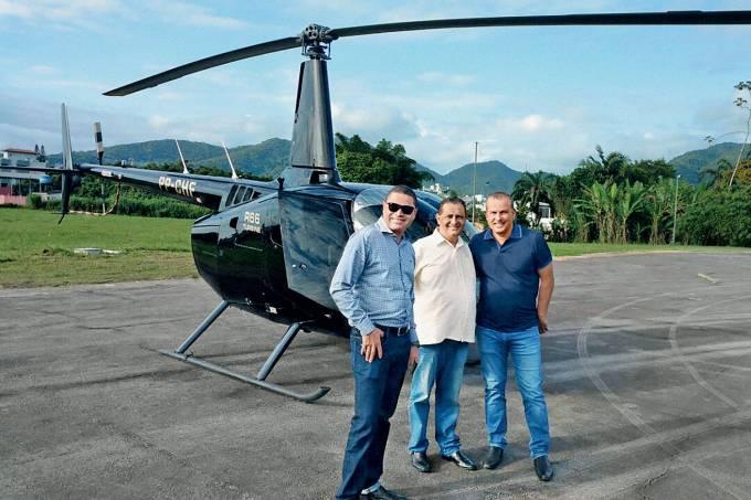 """""""ONÇA"""" – Euripedes Junior (à dir.) e o helicóptero do Pros: política, negócios e fortuna"""