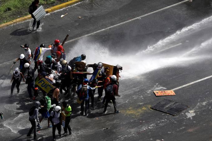 Manifestantes em Caracas, na Venezuela