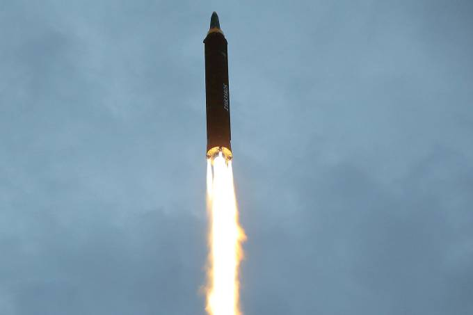 A missile is launched during a long and medium-range ballistic rocket launch drill
