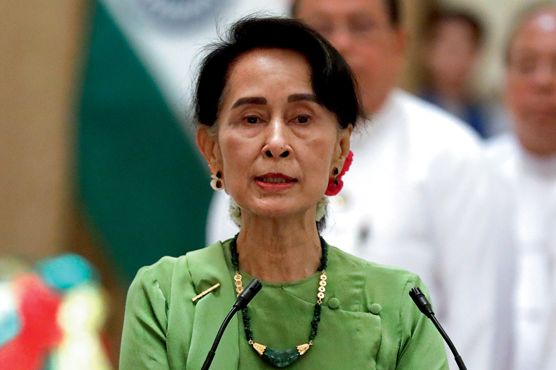 Myanmar State Counselor Aung San Suu Kyi talks during a news conference with India's Prime Minister Narendra Modi in Naypyitaw, Myanmar September 6, 2017. REUTERS/Soe Zeya Tun