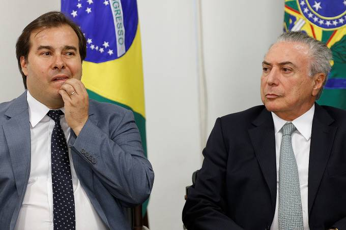 Brazil's President Michel Temer and Brazil's Lower House's President Rodrigo Maia attend a ceremony at the Planalto Palace in Brasilia