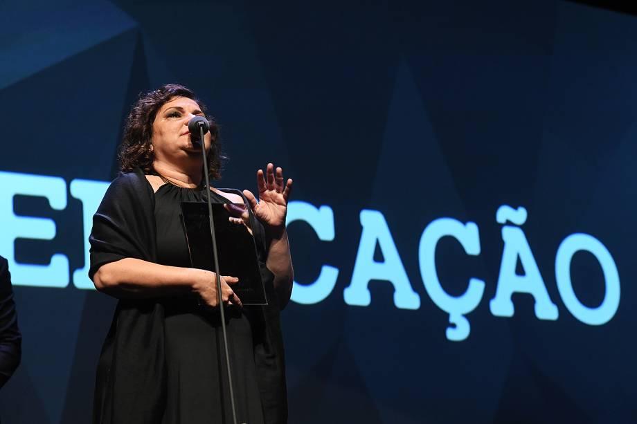 A professora Flávia Rezek recebeu o Prêmio Veja-se na categoria 'Educação'.Ela dirige uma escola pública que, apesar de situada em uma favela, está entre as quinze melhores do Brasil