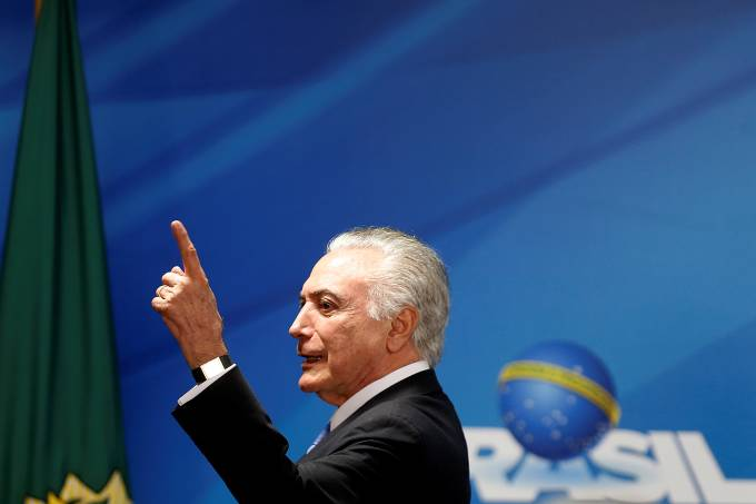 Brazil's President Michel Temer gestures as he speaks during the Petrobras 2018-2022 Business and Management Plan disclosure ceremony at the Planalto Palace in Brasilia
