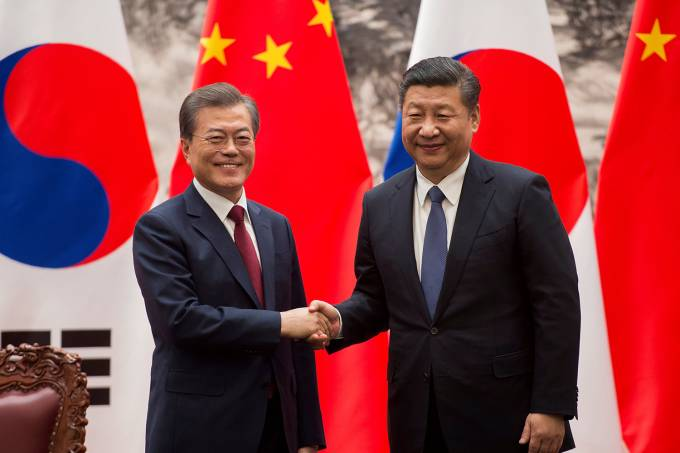 South Korean President Moon Jae-In and Chinese President Xi Jinping shake hands at the end of a signing ceremony at the Great Hall of the People in Beijing