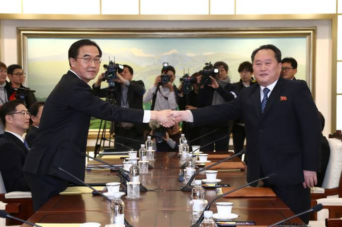 Head of the North Korean delegation, Ri Son Gwon shakes hands with his South Korean counterpart Cho Myoung-gyon during their meeting at the truce village of Panmunjom