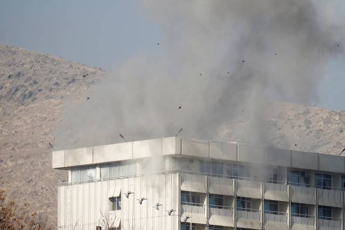 Smoke rises from the Intercontinental Hotel during an attack in Kabul
