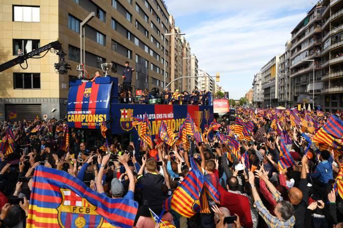 Catalães celebram títulos do Barcelona