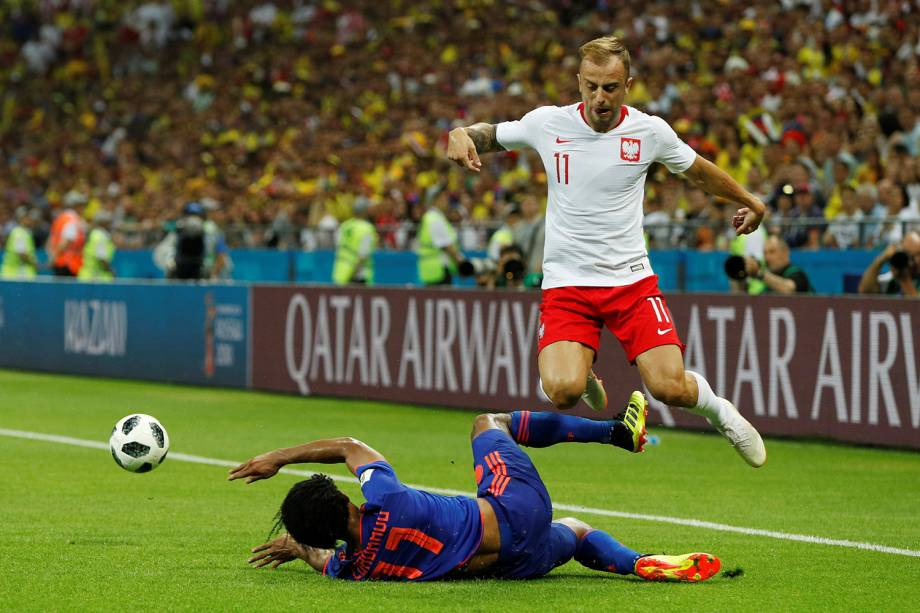 Soccer Football - World Cup - Group H - Poland vs Colombia - Kazan Arena, Kazan, Russia - June 24, 2018   Poland's Kamil Grosicki in action with Colombia's Juan Cuadrado      REUTERS/