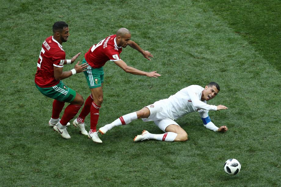 MOSCOW, RUSSIA - JUNE 20:  Cristiano Ronaldo of Portugal is tackled by Mehdi Benatia and Karim El Ahmadi of Morocco  during the 2018 FIFA World Cup Russia group B match between Portugal and Morocco at Luzhniki Stadium on June 20, 2018 in Moscow, Russia.  (Photo by Maddie Meyer/Getty Images)