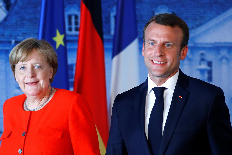 Merkel e Macron discordam sobre escolha de novos chefes da UE | VEJA