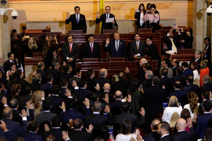 Members of the new congress, which includes former members of the FARC who were given ten seats as part of the 2016 peace process, are sworn in in Bogota