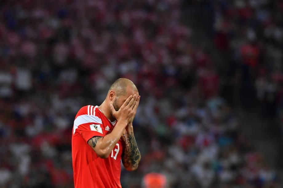 Fyodor Kudryashov, da Rússia, reage durante a partida de quartas de final contra a Croácia - 07/07/2018