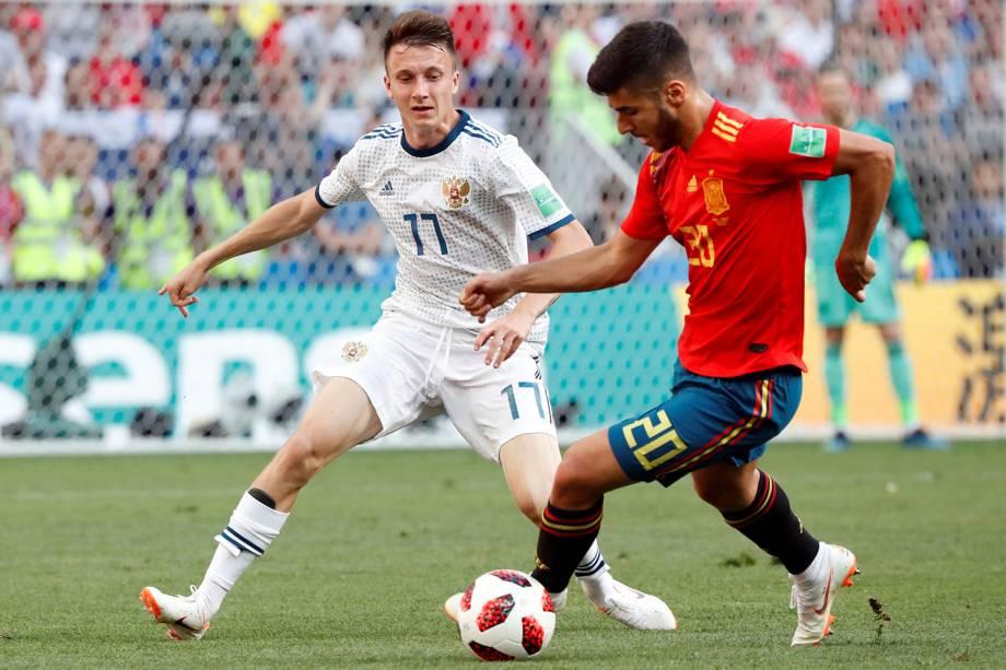 Marco Asensio da Espanha durante jogada contra Aleksandr Golovin  no Estádio Lujniki - 01/07/2018