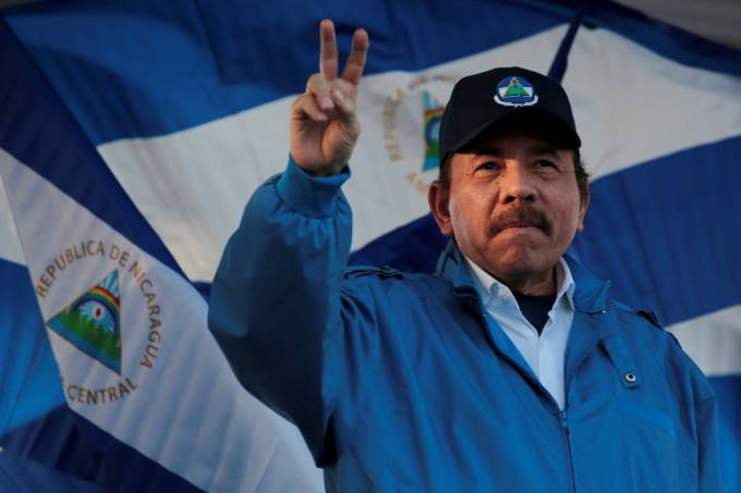 """FILE PHOTO: Nicaraguan President Daniel Ortega gestures during a march called """"We walk for peace and life. Justice"""" in Managua"""