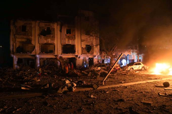 Flames are burning at the scene where a suicide car bomb exploded targeting a Mogadishu hotel in a business center in Maka Al Mukaram street in Mogadishu