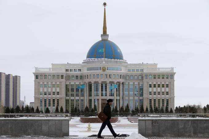 A man walks in front of Akorda, the official residence of Kazakhstan's President, in Astana