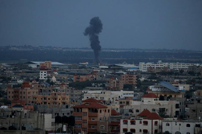 Smoke rises following an Israeli airstrike in the southern Gaza Strip