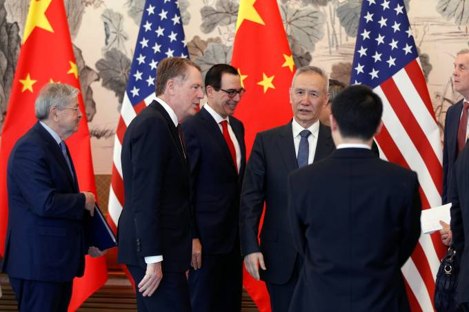 Chinese Vice Premier Liu He, U.S. Treasury Secretary Steven Mnuchin, U.S. Trade Representative Robert Lighthizer, and U.S. Ambassador to China Terry Branstad talk after concluding their meeting at the Diaoyutai State Guesthouse in Beijing
