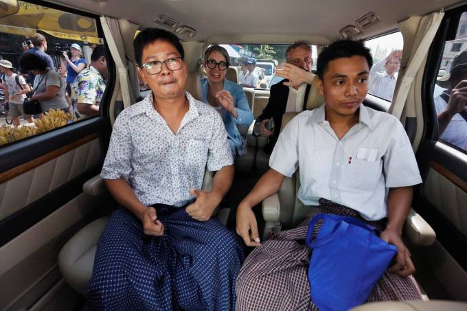 Reuters reporters Wa Lone and Kyaw Soe Oo react in a vehicle after being freed from Insein prison after receiving a presidential pardon in Yangon
