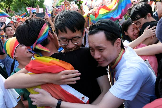 Same-sex marriage supporters celebrate after Taiwan became the first place in Asia to legalize same-sex marriage, outside the Legislative Yuan in Taipei