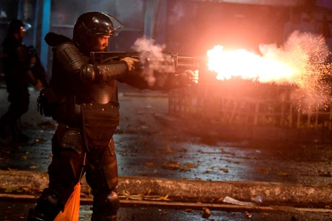 Police fire tear gas at protesters in Tanah Abang