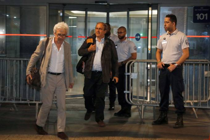 Former head of European football association UEFA Michel Platini and his lawyer William Bourdon leave a judicial police station where Platini was detained for questioning over the awarding of the 2022 World Cup soccer tournament, in Nanterre