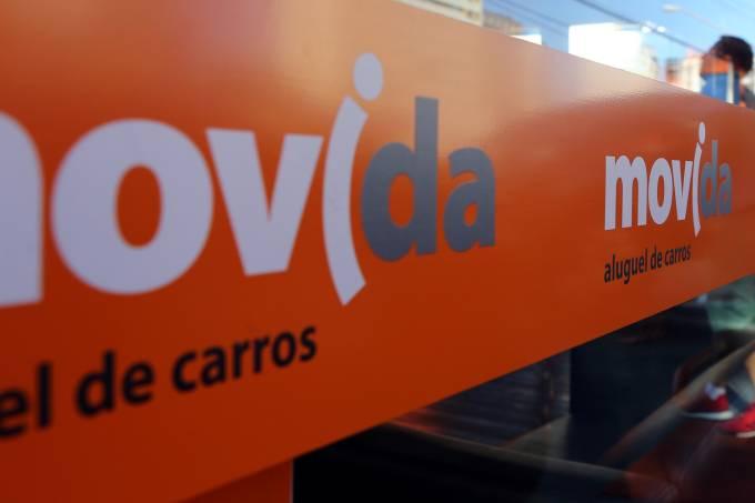 A consumer enters a Movida car rental service store in Sao Paulo