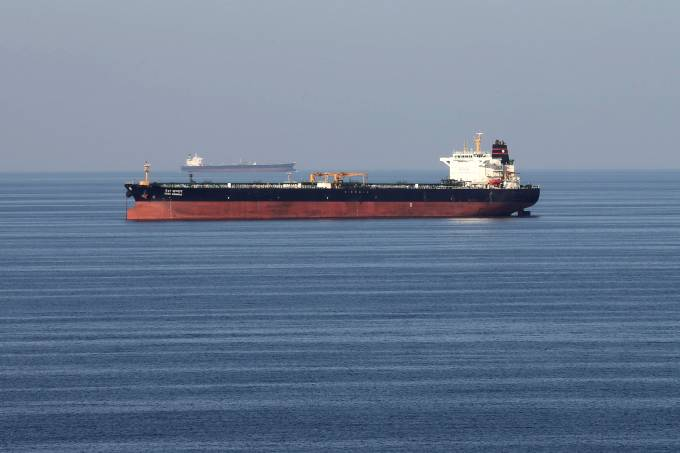 FILE PHOTO: Oil tankers pass through the Strait of Hormuz