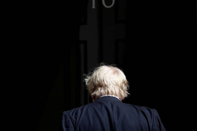 Boris Johnson arrives at 10 Downing Street, in central London