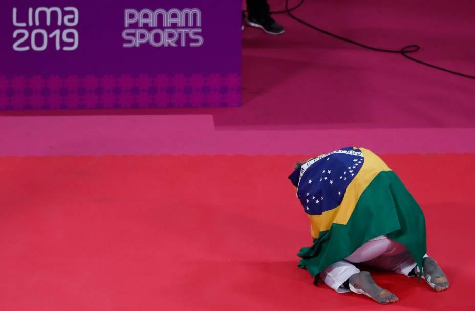 A brasileira Milena Titoneli comemora após derrotar o Paige McPherson, dos Estados Unidos, pela categoria de até 64kg no Taekwondo