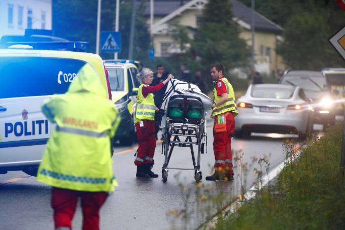 Emergency crews are seen near a stretcher after a shooting in al-Noor Islamic center mosque, near Oslo