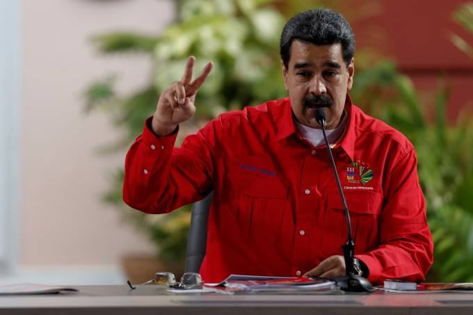 FILE PHOTO: Venezuela's President Nicolas Maduro takes part in a meeting with members of the Sao Paulo Forum in Caracas