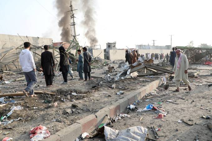 Afghan residents inspect the site of a blast in Kabul