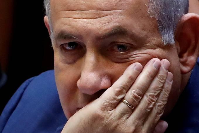 FILE PHOTO: Israeli Prime Minister Benjamin Netanyahu sits at the plenum at the Knesset, Israel's parliament, in Jerusalem