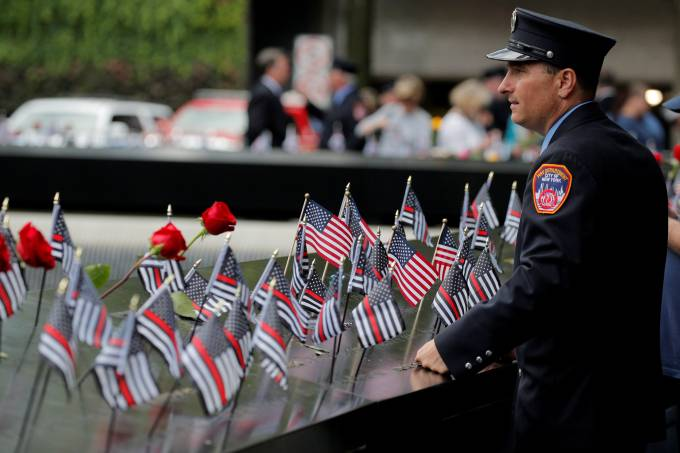 New York City Fire Department (FDNY) firefighter pauseS during ceremonies commemorating 18th anniversary of September 11, 2001 attacks at the 911 Memorial in New York