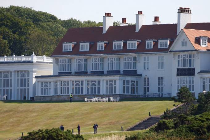 FILE PHOTO: A police offer stands in the grounds of the golf resort owned by U.S. President Donald Trump, during Trump's stay at the resort, in Turnberry