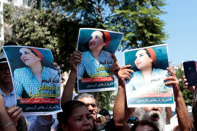 FILE PHOTO: Moroccan activists hold posters of Hajar Raissouni, a journalist charged with fornication and abortion, during a protest outside the Rabat tribunal