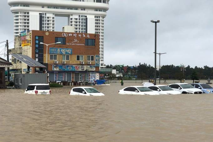 Cars are submerged in floodwater after Typhoon Mitag brought heavy rain and flood to Gangneung, South Korea