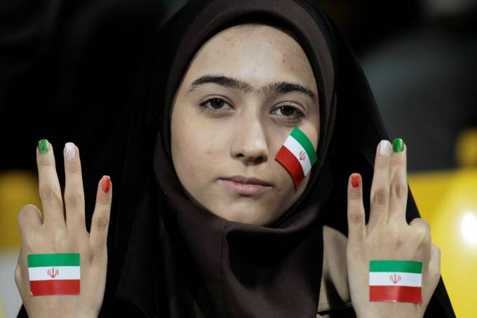 FILE PHOTO: An Iran fan gestures before their 2011 Asian Cup Group D soccer match against United Arab Emirates at Qatar Sports Club stadium in Doha