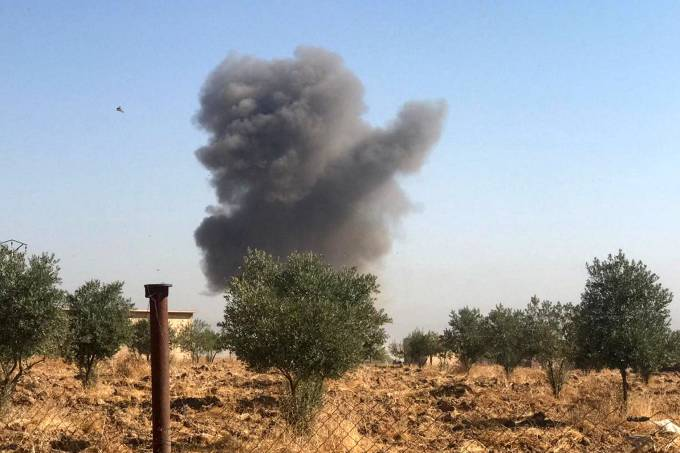 Smoke rises from Tel Arkam village in Ras al Ain countryside