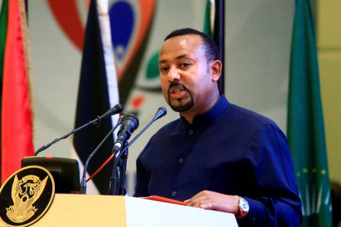 FILE PHOTO: Ethiopia's Prime Minister Abiy Ahmed addresses delegates during the signing of the Sudan's power sharing deal, in Khartoum