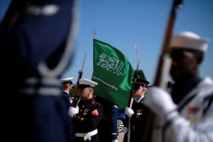 FILE PHOTO: The flag of the Kingdom of Saudi Arabia flies over a U.S. military honor guard awaiting the arrival of the Kingdom's Deputy Defense Minister Prince Khalid bin Salman at the Pentagon in Washington