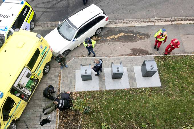 Police officers apprehend an armed man who stole an ambulance in Oslo