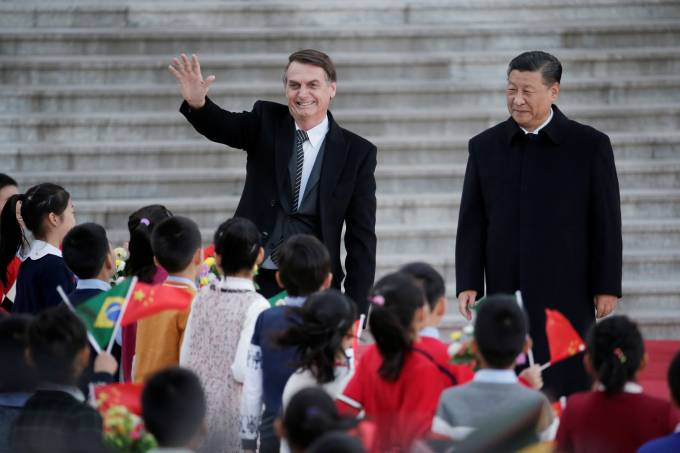 Brazilian President Jair Bolsonaro greets next to Chinese President Xi Jinping during a welcoming ceremony in Beijing