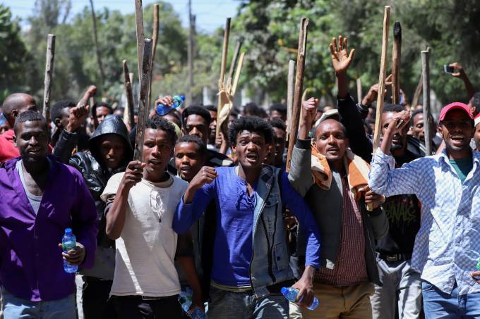 FILE PHOTO: Oromo youth chant slogans during a protest in-front of Jawar MohammedÕs house, an Oromo activist and leader of the Oromo protest in Addis Ababa, Ethiopia