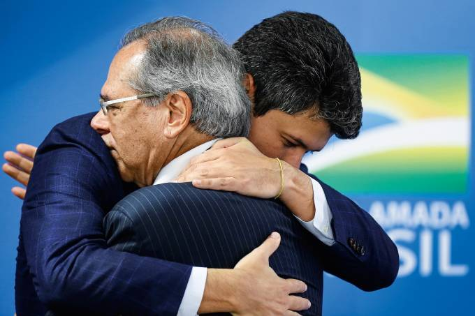 Brazil's Economy Minister Paulo Guedes greets Gustavo Henrique Moreira Montezano during his inauguration ceremony as the new Brazilian National Development Bank (BNDES) President at the Planalto Palace in Brasilia