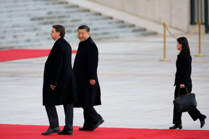 Brazilian President Jair Bolsonaro attends a welcome ceremony with Chinese President Xi Jinping outside the Great Hall of the People in Beijing